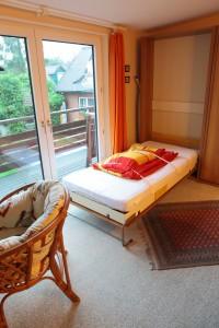 Whg 6 - Wohnzimmer mit Extrabett